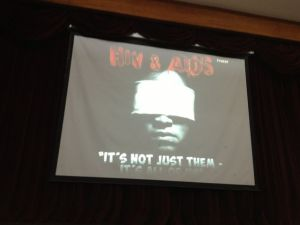 """It's not just them -- it's all of us"" -- the video wall at the talk in St. Paul's University Iloilo"