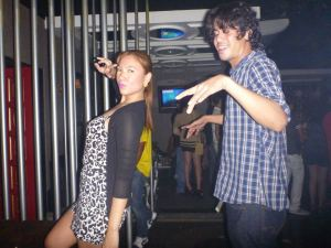 this is probably what I would look like dancing. Photo of me and Mikki, dancing at Flow in Iloilo, Dinagyang Festival 2012