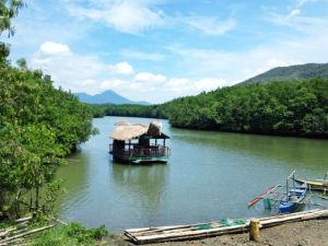 the floating restaurant in Barangay San Carlos in Puerto Princesa -- drift down a river with healthy mangroves on both sides of the embankment while you feast on delicious and fresh seafood fresh from the waters of Palawan