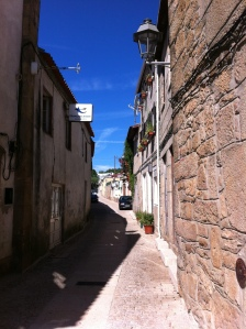 Coronel Jaime Neves -- one of the little streets that leads to the plaza to the church in the middle of Sabrosa
