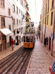 One of the tourist trams at Rua da Bica de Duarte Belo very near Bairro Alto in Lisbon