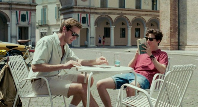 call-me-by-your-name-2017-003-armie-hammer-timothee-chalamet-cafe-table_0